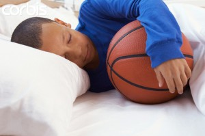 Boy sleeping with basketball