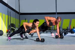 bigstock-Gym-man-and-woman-push-up-stre-40734724[1]