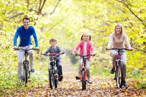 family-riding-exercising-together-on-bikes-in-autumn[1]